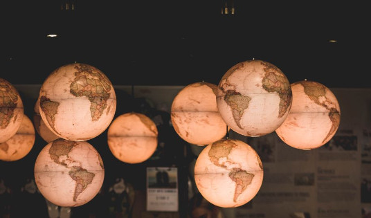 Globes hanging in the air and backlit so that they glow.
